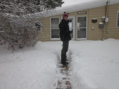 Shoveling to check in on our summer cottage.  By shoveling I mean him, not me!