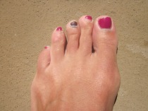 A little side effect from the high mileage.  My poor middle toe has no polish on it.  So ugly but that's the way  running goes!